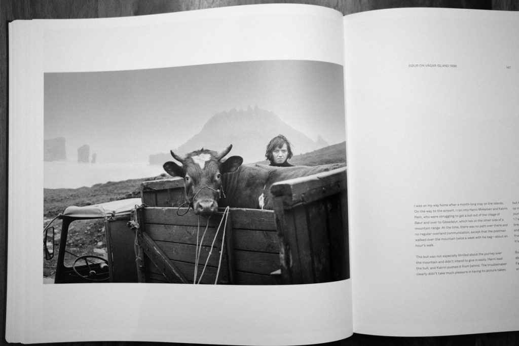 Photo of a woman and a cow in the Faroe Islands, from Faces of the North