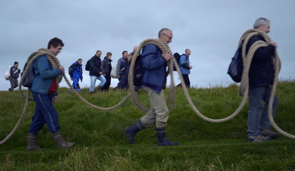 Men with bird hunting ropes on the Faroe Islands