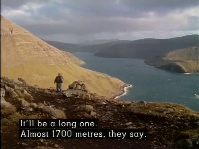 A man walks along the top of the mountain ride with the caption: It'll be a long one. Almost 1700 metres, they say.